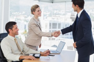 Business people shaking hands with their future patner in their office
